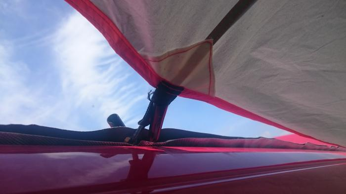 Awning attached to kador strip using toggles and eyelets