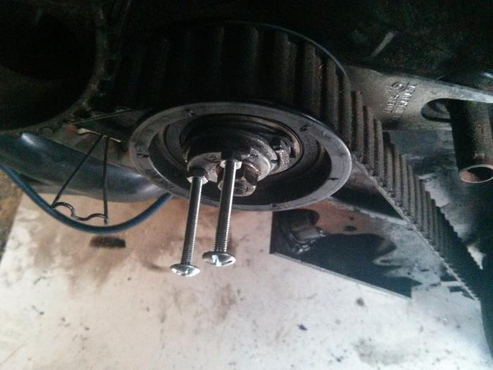using bolts to help with timing belt tensioner