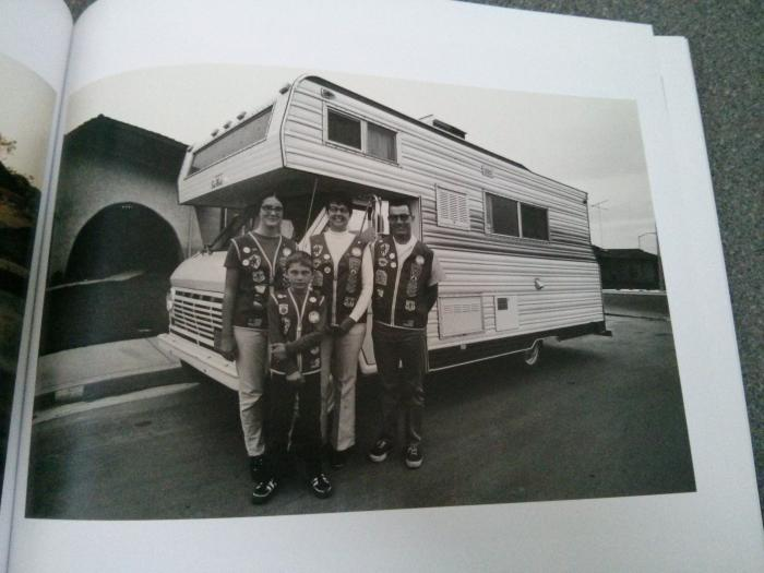 photo of family stood by their camper