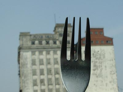 fork in front of derelict flour mill