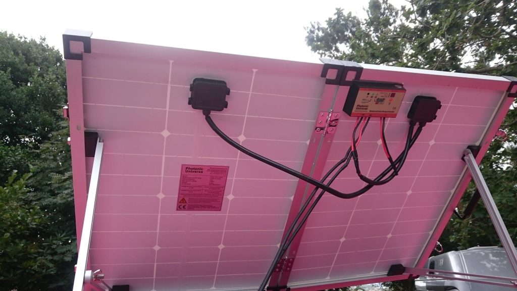 Photonic Universe portable 100 watt solar panel kit showing charge controller